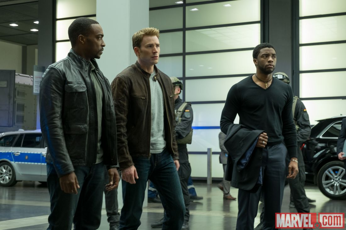 Sam, Steve, and T'Challa surrounded by guards
