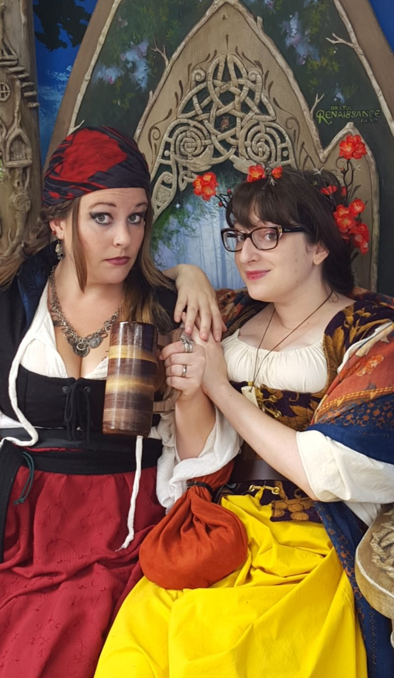 Joanna dressed as an 18th century pirate and Summer in a late 17th century costume at a Renaissance Festival