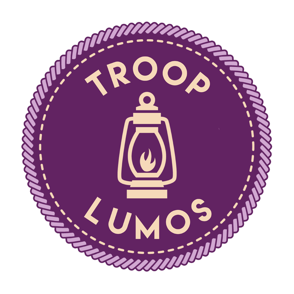 "A purple merit badge that reads ""Troop Lumos"" with a lantern image centered."