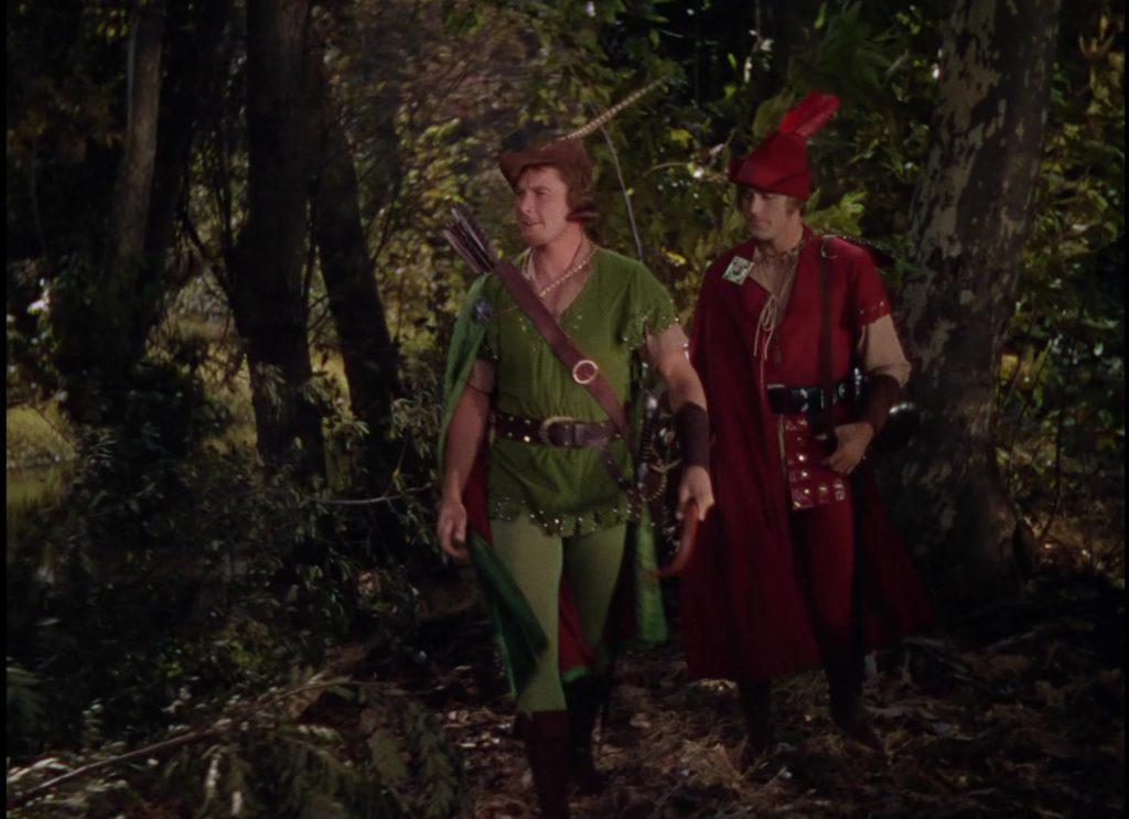 Still of Errol Flynn from the 1938 movie Robin Hood wearing a green tunic.