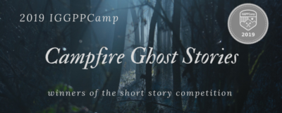 """A background of a shadowed and eerie forest. In the upper left corner """"IGGPPCamp 2019"""". The centered title """"Campfire Ghost Stories"""". A subscript """"winners of the short story competition"""""""
