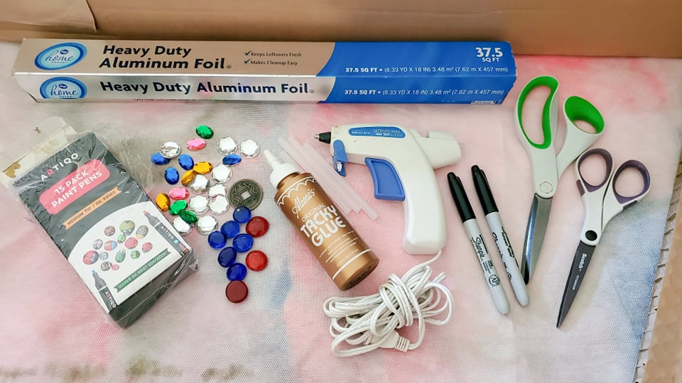all of the supplies needed to make a cardboard sword as listed below