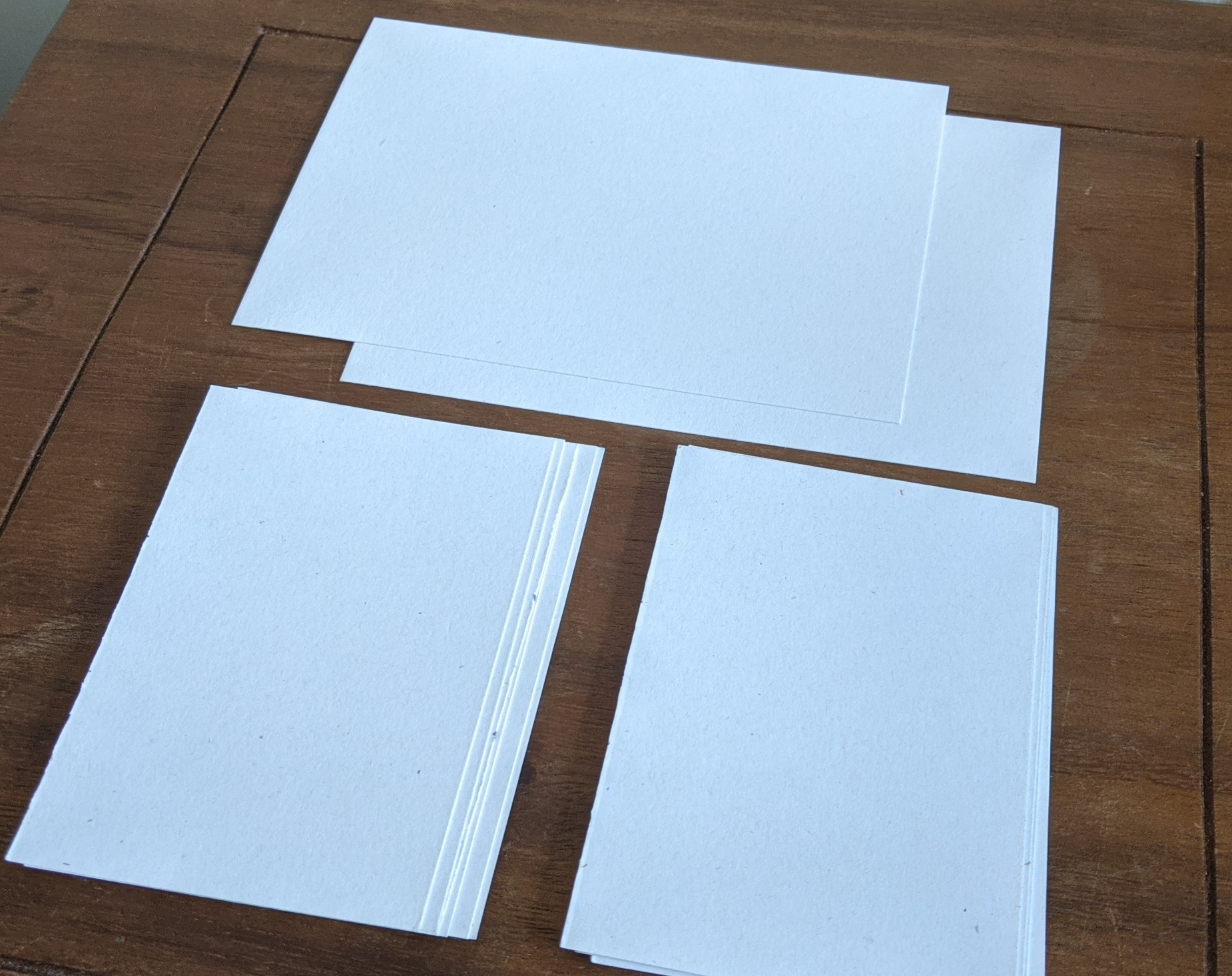 pieces of paper, cut in 2 even halves