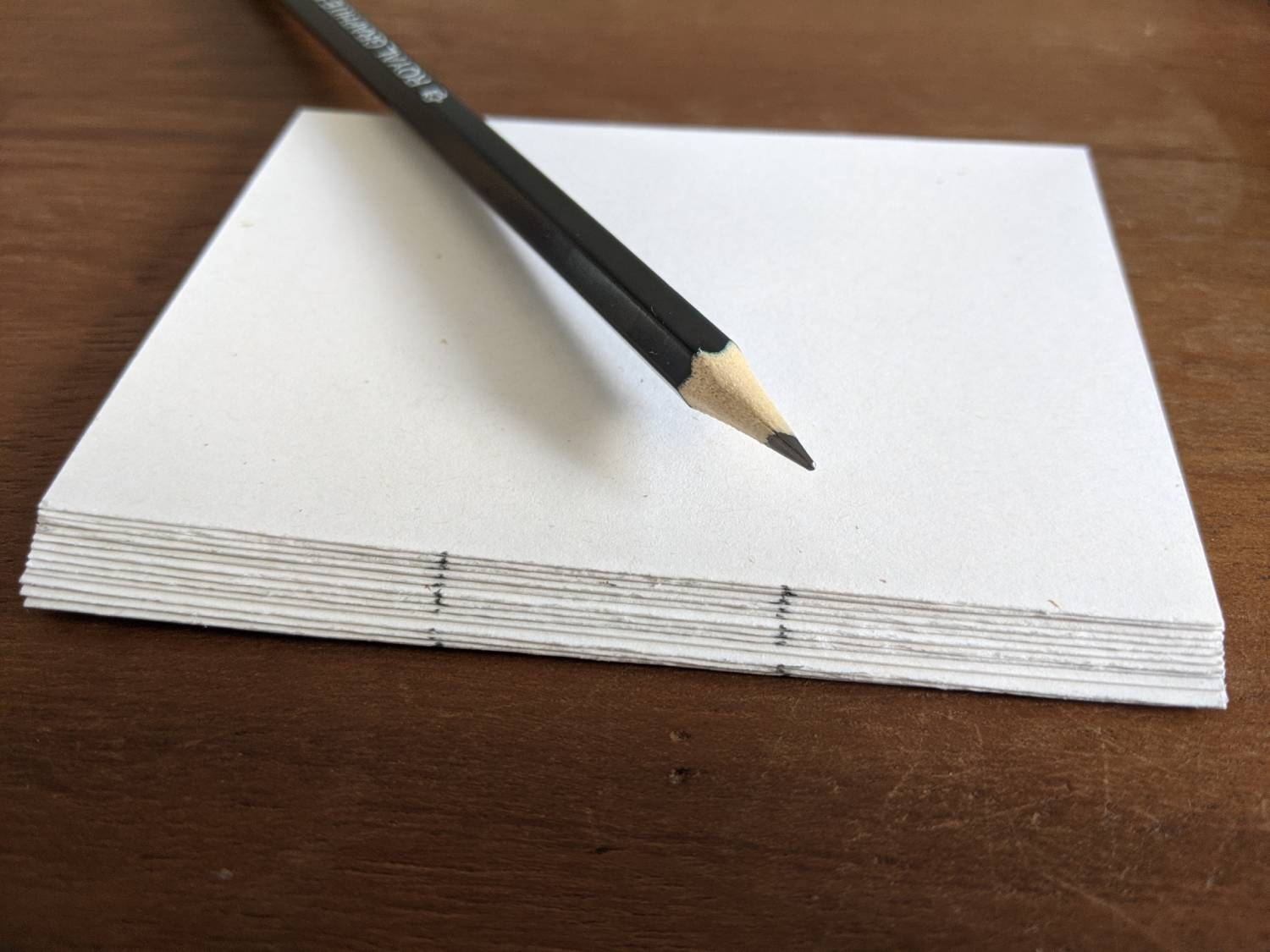 A stack of the paper halved with 2 marks along the edge