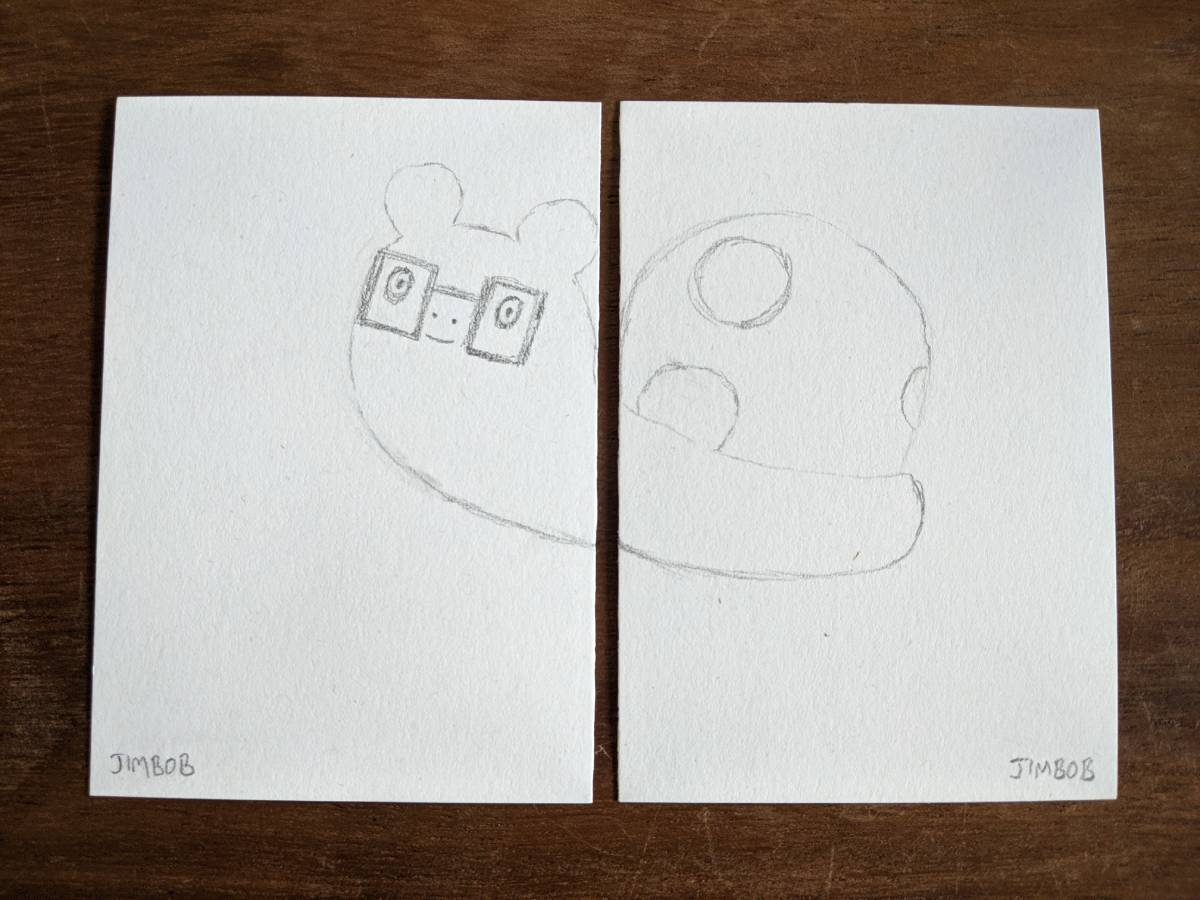 a sketch of JimBob the snail over 2 pieces of paper so that the body is split in half where the 2 marks line up